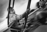 A Girl enjoys a ride at the county fair.