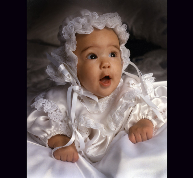 A baby's baptismal portrait is always a hit with family members