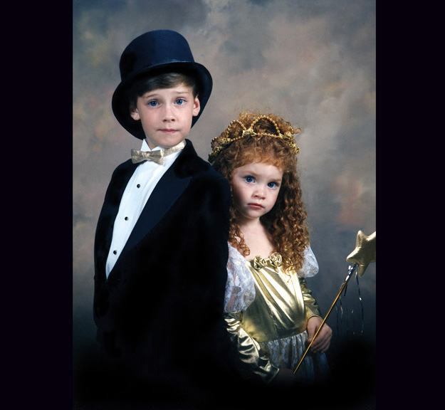 A brother and sister dress up for a portrait