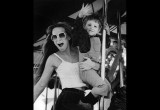 A woman and her nephew enjoy a Merry-go-round.