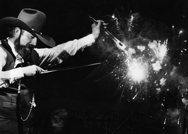 Charlie Daniels' fiddle is seeming ablaze in a double exposure superimposed effect.