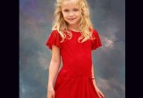 Little Alyssa in a red dress