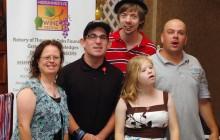 Special Olympians Posing at a Summer fundraiser