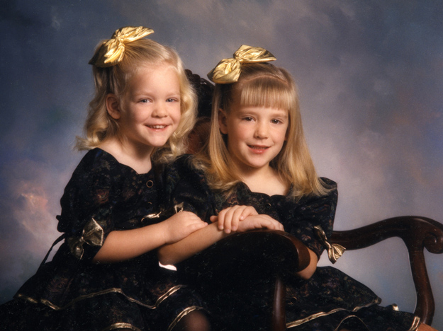 Two sisters in a studio portrait pose