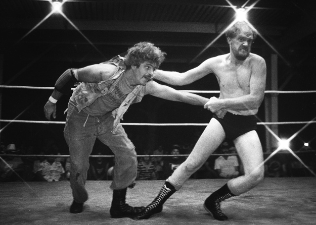 Wrestling action entertains the fair's audience.