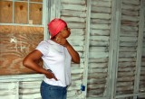 A Hurricane Katrina victim surveys improvements being done to her home