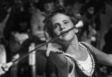 A baton twirler peforms for parade goers