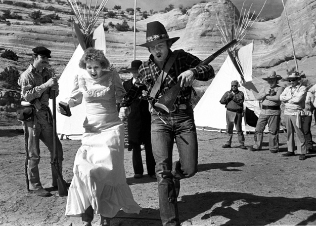 A couple is just married at a New Mexico Mountain Men Rendezvous, (Gallup, NM - 1981).