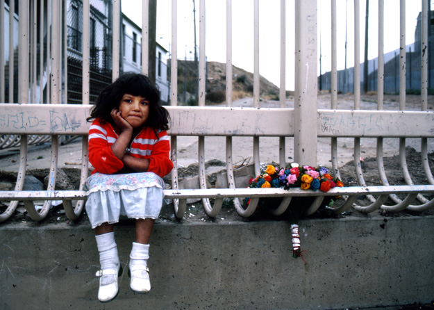 A young Mexican girl poses for a portrait, (Tijuana, BC - 1982).