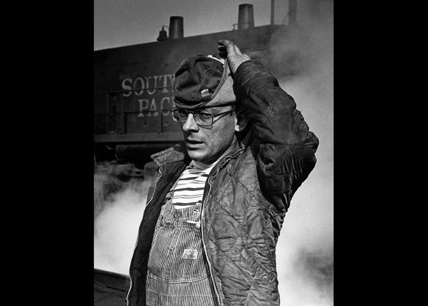 At a San Jose train yard, a locomotive mechanic takes time for a portrait, (San Jose, CA - 1978).