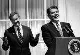 President Reagan and former congressman Robert Lagomarsino share a laugh together at a media event
