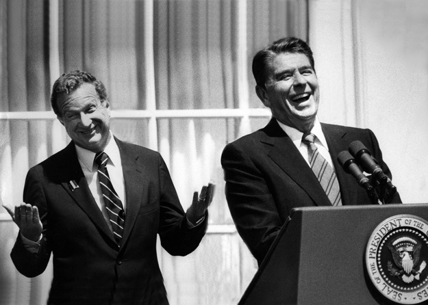 President Ronald Reagan and former congressman Robert Lagomarsino share a laugh together at a media event, (Santa Barbara, CA - 1983).