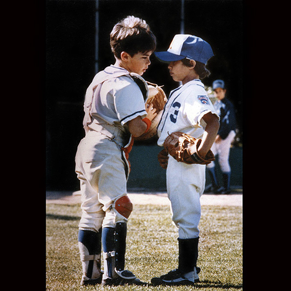 1979 - Two Little League players from Santa Clara, CA discuss strategy with each other.
