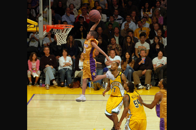 2007 - In this fun photo, Dan photographed a youngster slam dunking at his house, then went to a L.A. Laker - Seattle Supersonics game, took a few pictures from the correct angle, then superimposed the young star going high above the pros.