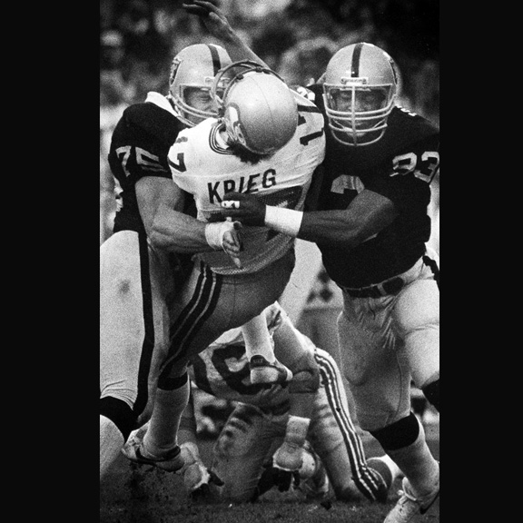 1984 - Two L.A. Raiders players take QB Dave Krieg airborne in the AFC Championship game.
